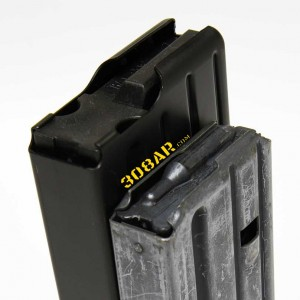 Picture of an AR-15 Magazine Next To a 308 AR Magazine