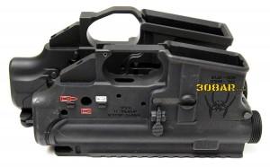 Bottom angled side view visual size comparison of a Spikes Tactical AR15 Receiver Set for .223 Remington and a Mega Arms MA-TEN 308AR AR308 Receiver Set for .308 Winchester - 308 AR15 , AR15 vs AR-10 308AR AR308